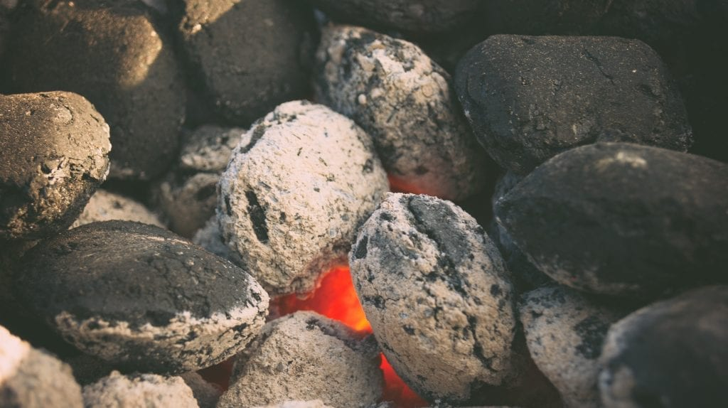 A picture of white-hot charcoal ready to grill