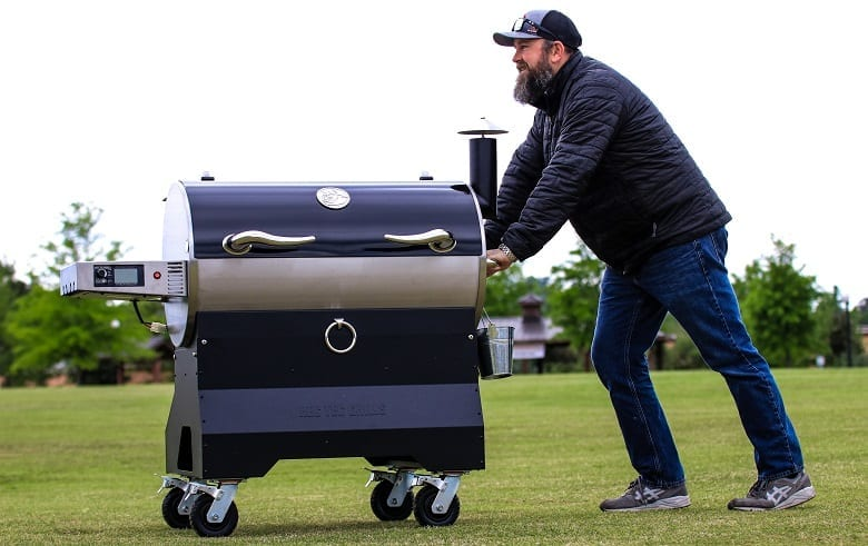 Man Pushing REC TEC Grill